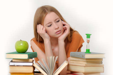 girl student with books, apple and sand-glasses Stock Photo - 13683001
