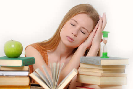 girl student with books, apple and sand-glasses Stock Photo - 13683002
