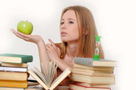 girl student with books, apple and sand-glasses Stock Photo - 13664035