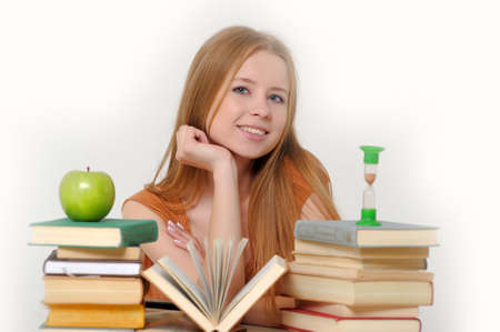 girl student with books, apple and sand-glasses Stock Photo - 13664034