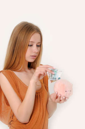 woman with piggy bank and money Stock Photo - 13664043