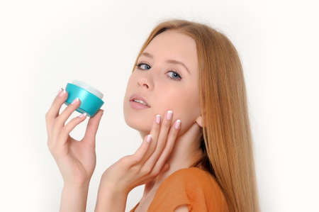 Girl holding a box of cosmetic cream Stock Photo - 13683010