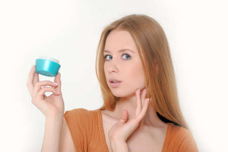 Girl holding a box of cosmetic cream Stock Photo - 13664040