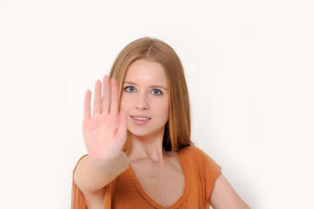 Woman making stop gesture photo