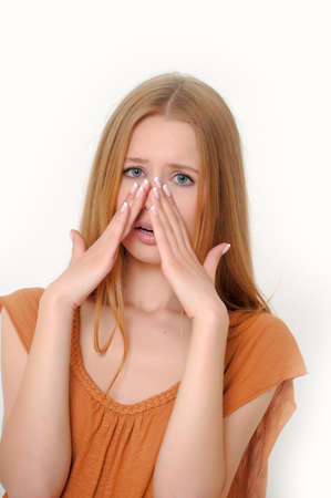 holding nose: Pretty Woman Sneezing Stock Photo