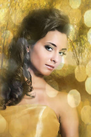 Beautiful girl in golden dress Stock Photo - 13837741