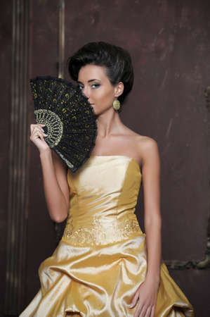 Beautiful girl in golden dress Stock Photo - 13837744