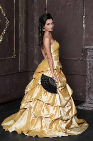 Beautiful girl in golden dress Stock Photo - 13837748