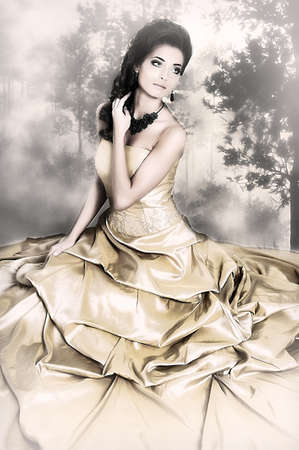 Beautiful girl in golden dress Stock Photo - 13837768