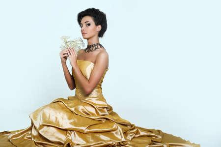Beautiful girl in golden dress photo