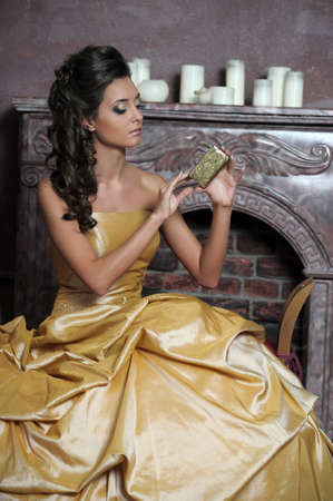 Beautiful girl in golden dress photo