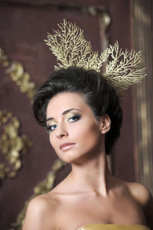 Luxurious glamorous models in gold  photo