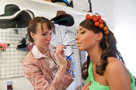 the stylist paints model in a make-up room before shooting Stock Photo - 13909676