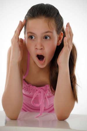 teen girl face: Shocked teen girl Stock Photo
