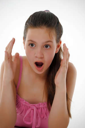 aghast: Shocked teen girl Stock Photo