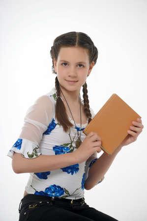 Teen girl posing with book