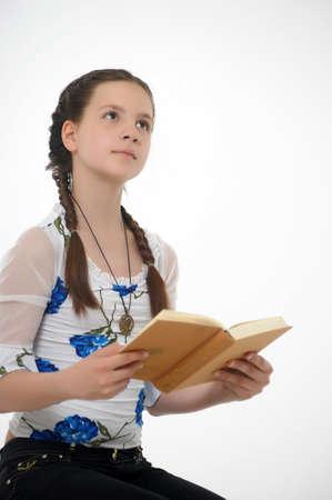 Teen girl posing with  book photo