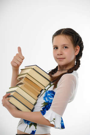 teen girl and a stack of books Stock Photo - 14404660