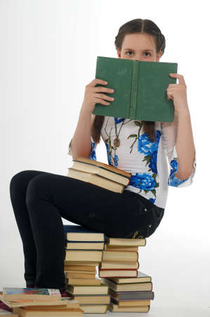 teen girl and a stack of books Stock Photo - 14404657