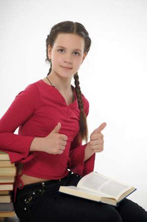 teen girl and a stack of books Stock Photo - 14404659