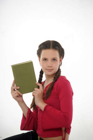 Teen girl posing with  book photo