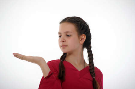 Girl showing something on the palm of her hand photo