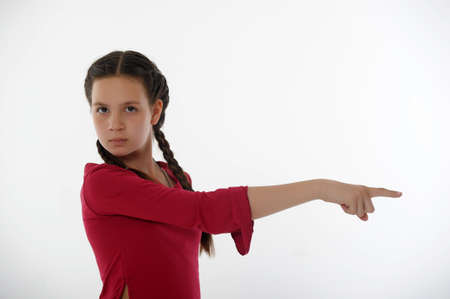 Young teenage girl pointing finger photo
