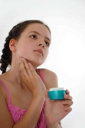Applying hand cream photo