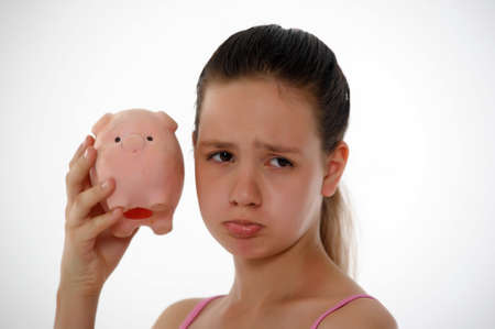 teen girl with a piggy bank in hand Stock Photo - 14167176