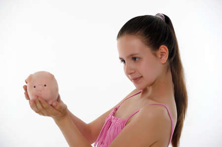 teen girl with a piggy bank in hand Stock Photo - 14167177