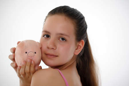 teen girl with a piggy bank in hand Stock Photo - 14167182