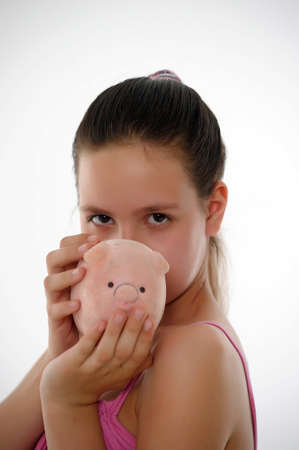 teen girl with a piggy bank in hand  photo