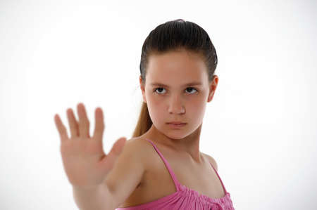 Teen girl shows gesture of stopping Stock Photo - 14329212