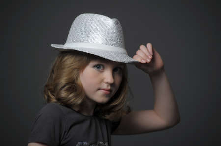 teen girl in a hat dancer photo