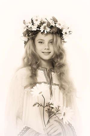 Beautiful girl in wreath of daisies Stock Photo - 14329632