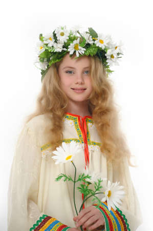Beautiful girl in wreath of daisies photo