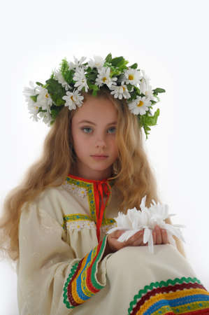 Beautiful Russian girl with a wreath photo
