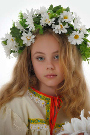 Beautiful Russian girl with a wreath photo