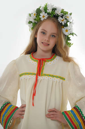 Beautiful Russian girl with a wreath Stock Photo - 14329690