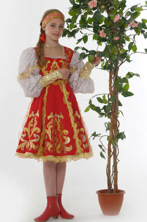red rose bokeh: girl  In Russian Traditional Clothing