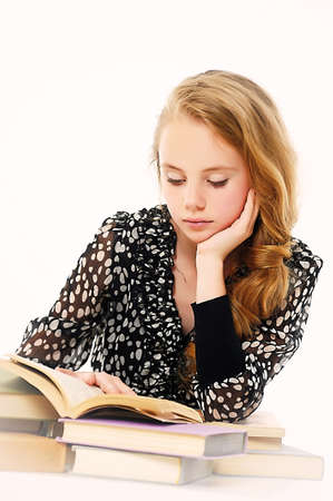Girl  is reading book Stock Photo - 14330657