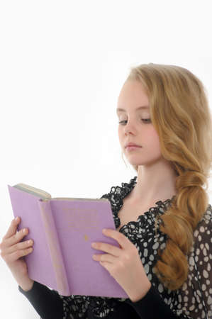 little table: Girl  is reading book Stock Photo