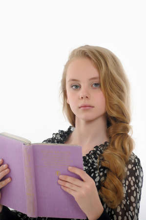 Girl  is reading book Stock Photo - 14330653