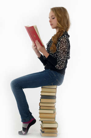Girl  is reading book Stock Photo - 14330631