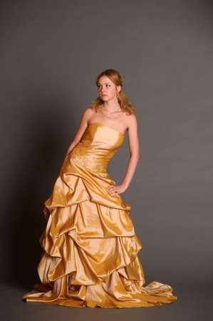 Blonde in the  gold dress Stock Photo - 14293429