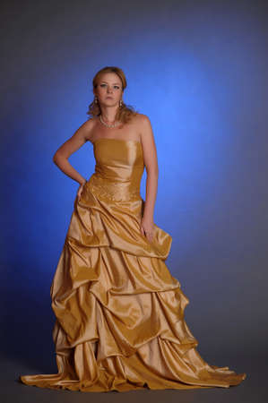 Blonde in the  gold dress photo