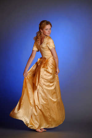 beautiful young woman in gold dress Stock Photo - 14293547
