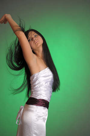 long-haired beautiful woman in a white dress photo