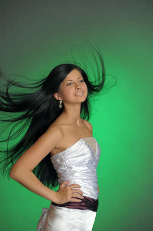 long-haired beautiful woman in a white dress Stock Photo - 14577884
