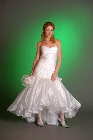 beautiful young woman in a wedding dress in the studio photo